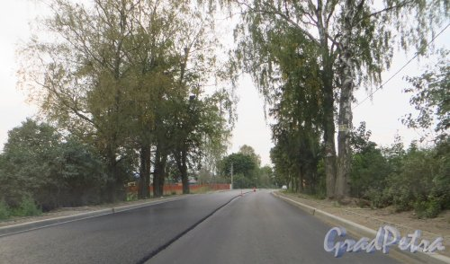 Автодорога Н73 (Новая Пустошь-Невская Дубровка). Участок отремонтированный дороги в посёлке Хапо-Ое. Фото 10 сентября 2014 года.