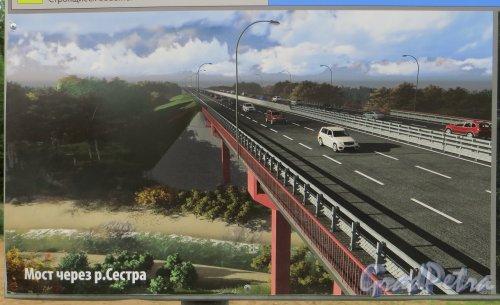 Информационный щит о работах по реконструкции трассы Е-18 «Скандинавия». Проект моста через реку Сестра на 47 километре. Фото 12 июля 2015 года.