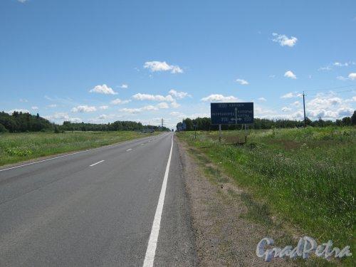 Лен. обл., Ломоносовский р-н, шоссе А-120. Вид в сторону пересечения с шоссе 41К-008 (Р-35, Гостилицкое шоссе). Фото 28 июня 2012 г.