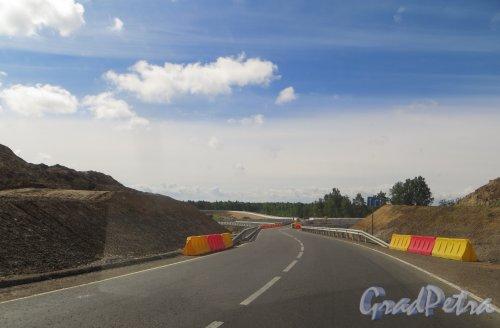 Реконструкция развязки трассы Е-18 «Скандинавия» и шоссе 41А-180 («Парголово-Огоньки»). Съезды №7 (в сторону Санкт-Петербурга). Фото 27 июля 2015 года.