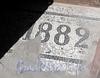 Ул. Достоевского, д. 23. Бывший доходный дом. Дата постройки здания при входе в парадную. Фото июль 2009 г.