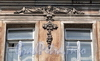 Ул. Достоевского, д. 27. Бывший доходный дом. Художественное оформление фасада. Фото июль 2009 г.