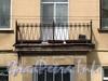 Кирочная ул., д. 8, лит. А (лицевой корпус). Решетка балкона. Фото май 2010 г.
