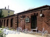 Смоленская ул., д. 18-20. Уцелевшая стена лицевого флигеля. Фото июль 2010 г.