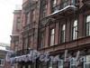 Ул. Достоевского, д. 29 / Социалистическая ул., д. 18. Угловая часть фасада по улице Достоевского. Фото февраль 2011 г.