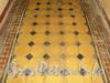 Ул. Блохина, д. 1 / Кронверкский пр., д. 75. Напольная керамическая плитка в одной из парадных дома. Фото июль 2011 г.
