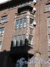 город Выборг, Крепостная ул., 32.жилое здание с магазинами в стиле северного модерна. Фрагмент фасада. Фото апрель 2014 г.